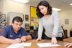 LMC Transition Specialist Catherine Fonseca answers questions with an Adult Education student at Pittsburg Adult Education.